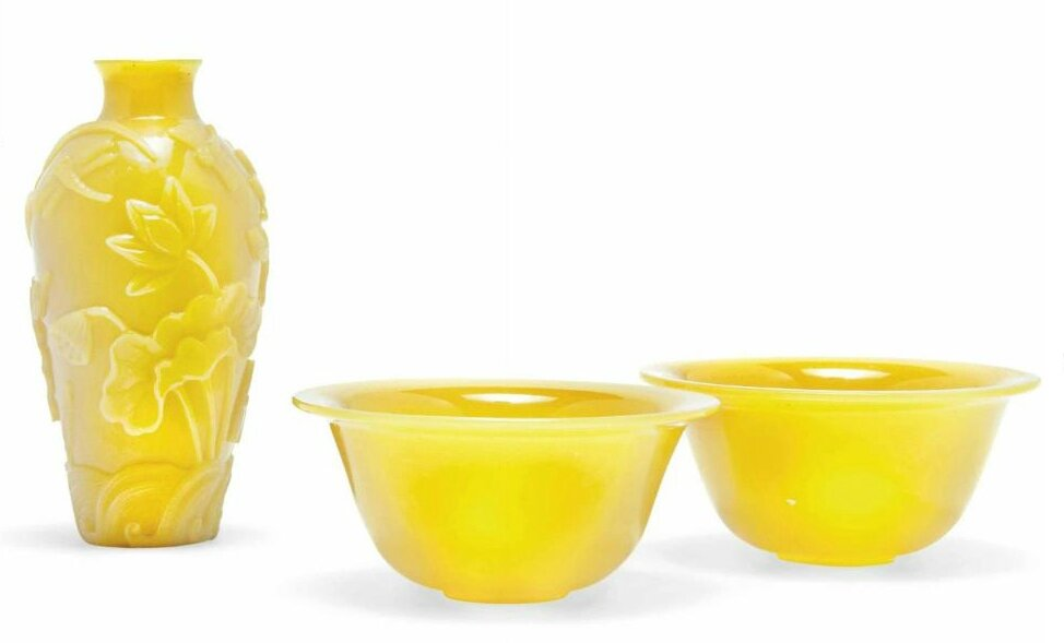 A pair of Chinese yellow glass wine cups and a carved yellow glass vase , 20th century
