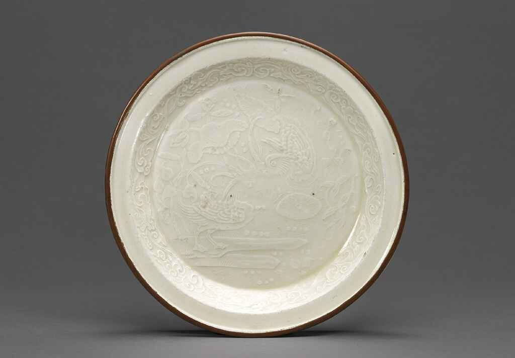 A rare small moulded 'mandarin ducks' Ding dish, Jin dynasty (1115-1234)