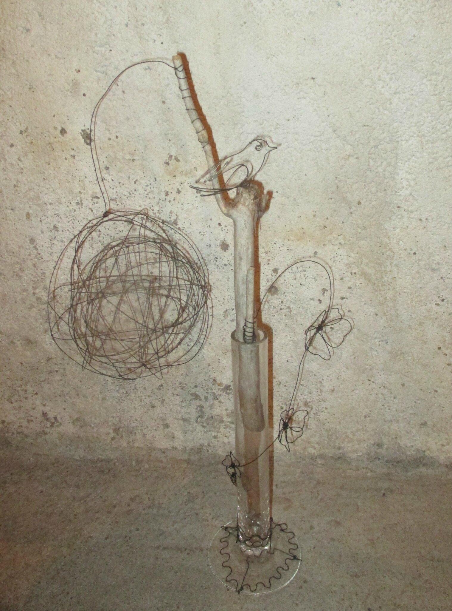 sculpture oiseau soliflore