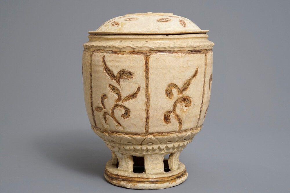 A Vietnamese jar and cover on reticulated stand, Trần dynasty, 13th-15th century