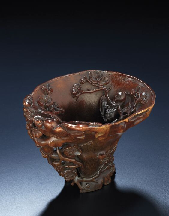 An exquisitely carved rhinoceros horn libation cup, Qing dynasty, 17th-18th century