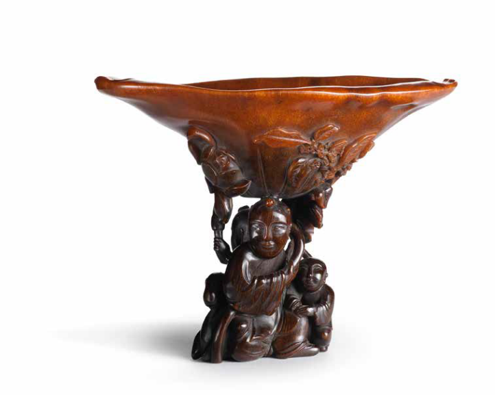 An exceptionally rare rhinoceros horn 'boys and goat' libation cup, 17th-18th century