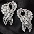 A pair of diamond clip brooches, by cartier, circa 1950