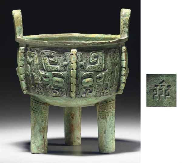 A well-cast bronze tripod ritual food vessel, ding, Late Shang dynasty, 12th-11th century BC