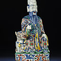 A large and rare Ming wucai seated figure of Shoulao, Wanli period (1573-1620)