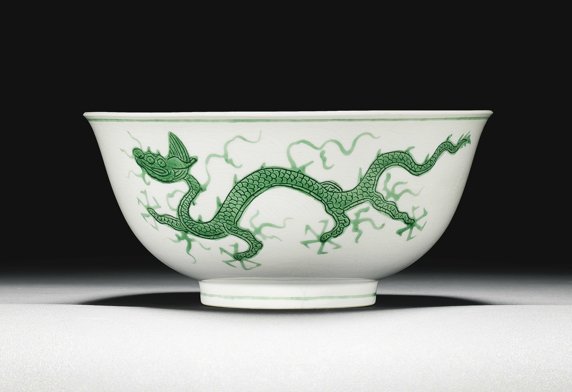 An incised green-enamelled 'dragon' bowl, Zhengde mark and period