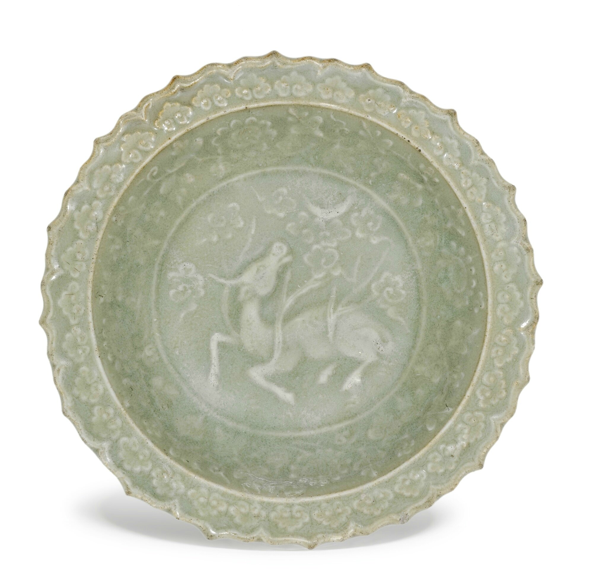 A small moulded 'Longquan' celadon dish, 14th Century