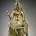 A small gilt-bronze figure of avalokitesvara, tang dynasty (618-907)