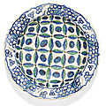 An iznik polychrome pottery dish with stylised cloud and cintamani design, turkey, circa 1580-85