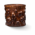 A carved huanghuali 'faux burl' brush pot, qing dynasty, 18th century