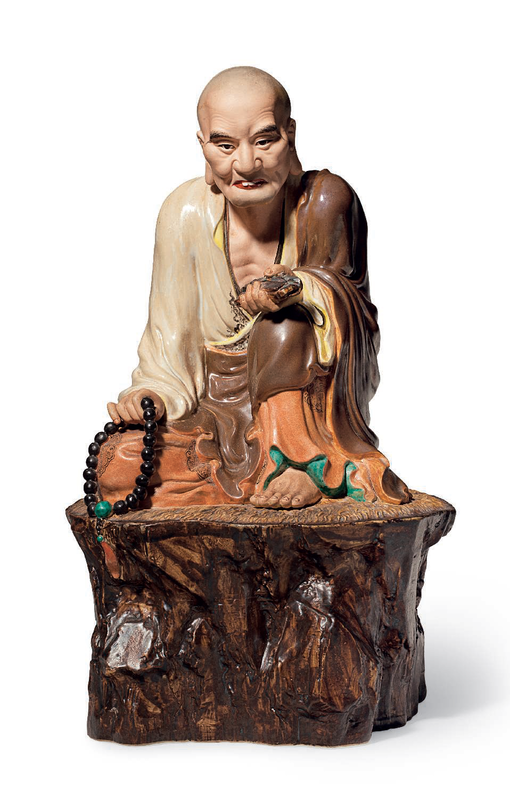 A polychrome-enameled and biscuit figure of a seated luohan, impressed seal of Zeng Longsheng, Republic period