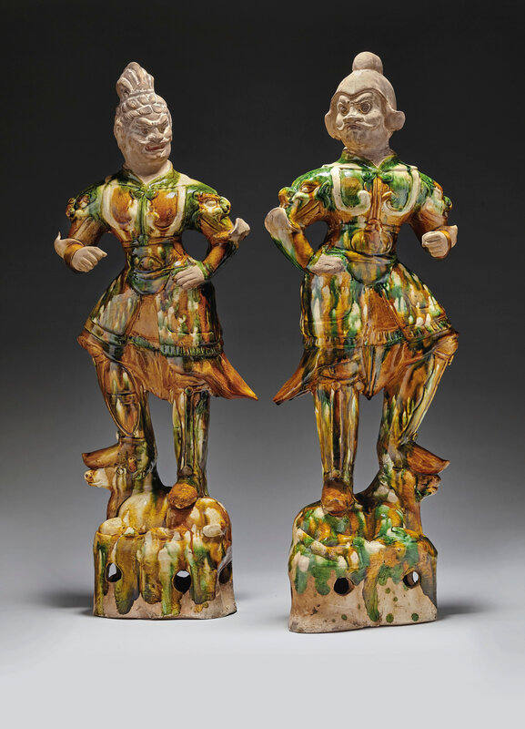 A pair of large sancai-glazed pottery guardian figures, Tang dynasty (618-907)