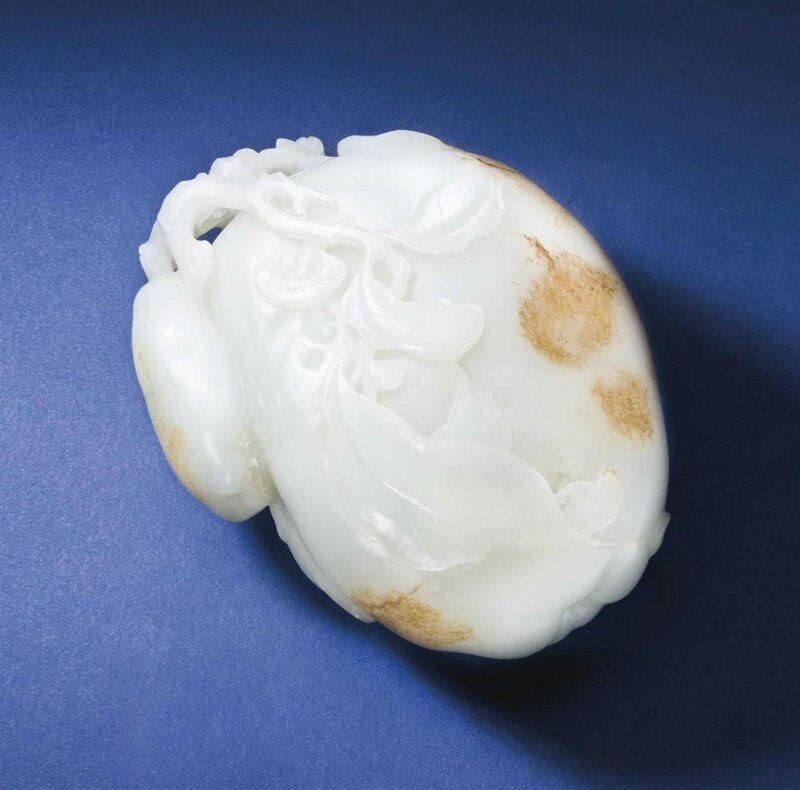 A large well-carved pale greenish-white jade carving of quince, Qianlong period (1736-1795)