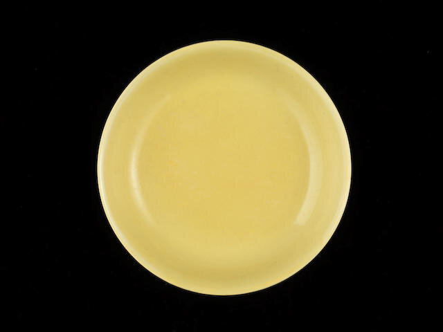 A yellow-glazed saucer dish, Hongzhi six-character mark and of the period (1487-1505)
