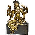 A rare gilt-copper figure of vasudhara, nepal, 14th –15th century