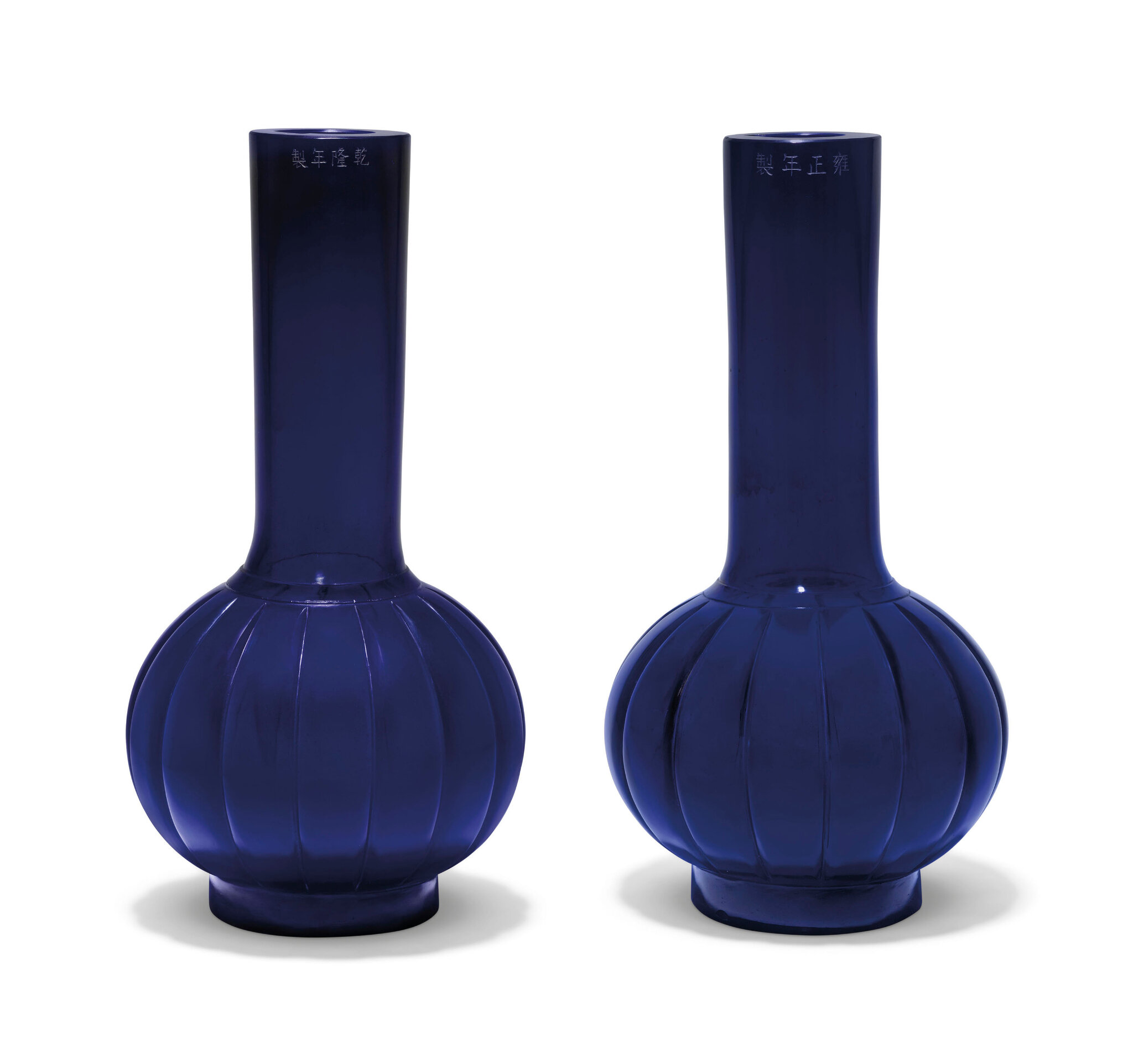 Two similar translucent blue glass lobed bottle vases, 19th century