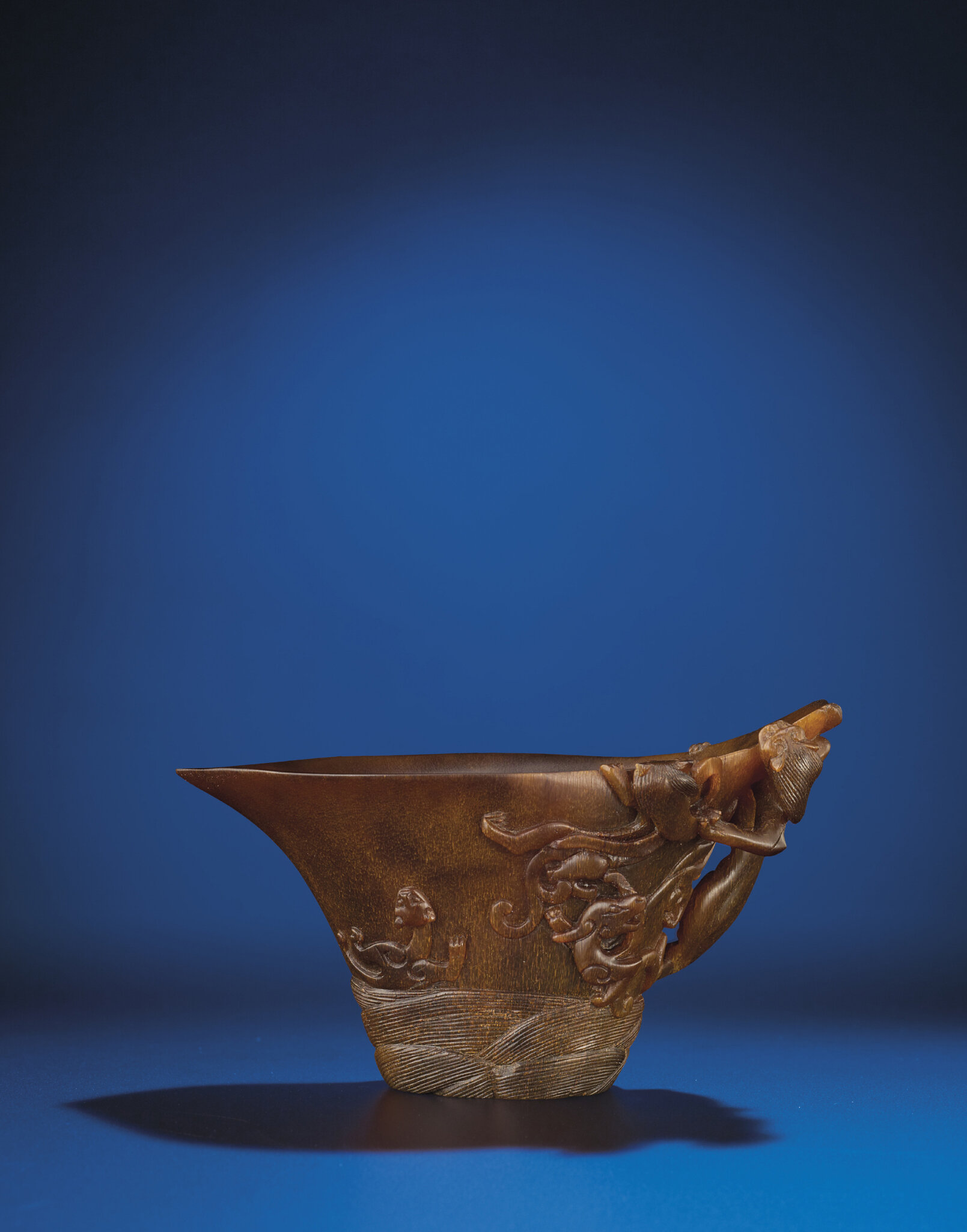 A rhinoceros horn 'chilong' libation cup, Qing dynasty, 18th century