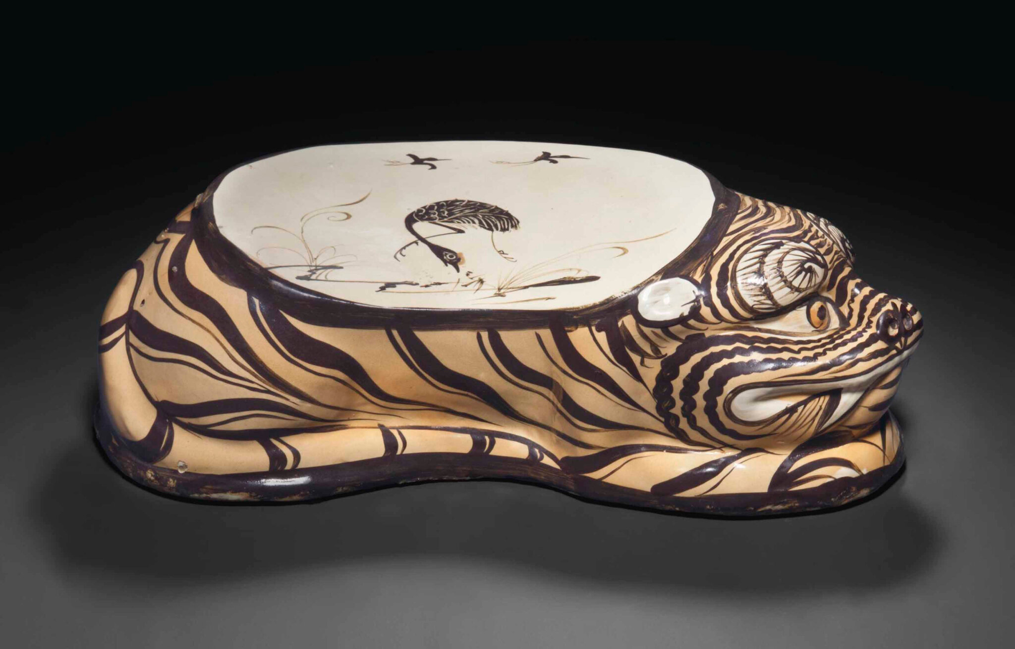 A Cizhou-type painted tiger-form pillow, Jin-Yuan Dynasty, 12th-13th century