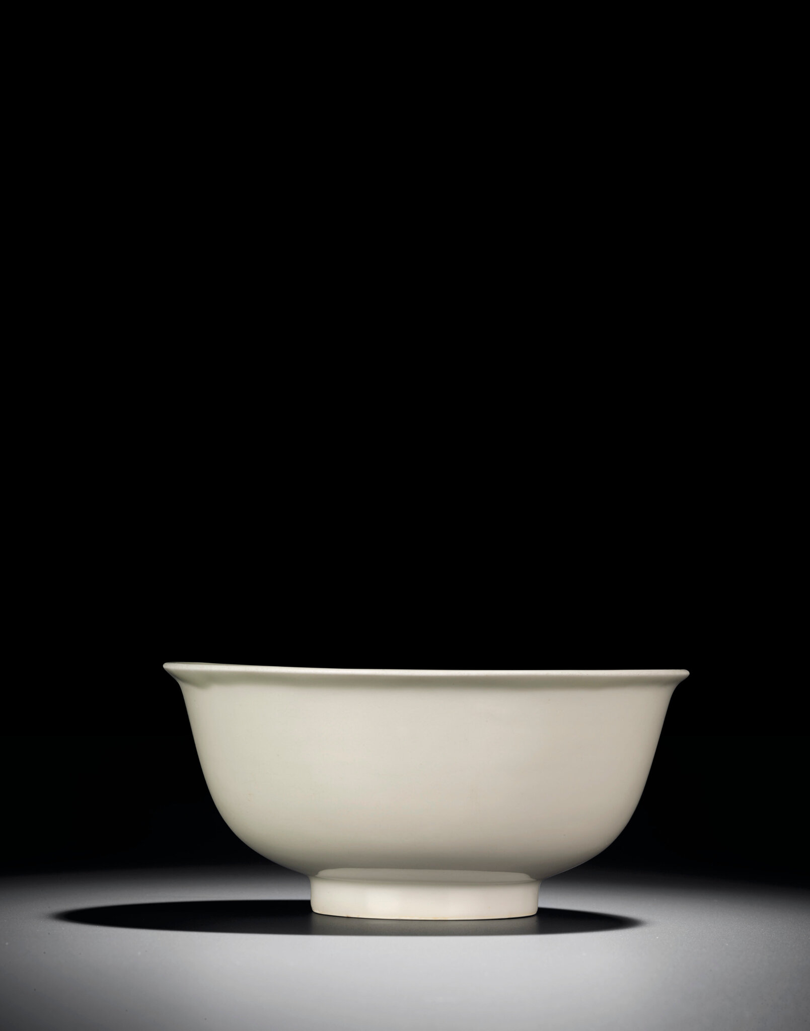A rare incised and moulded white-glazed bowl, Hongwu period (1368-1398)