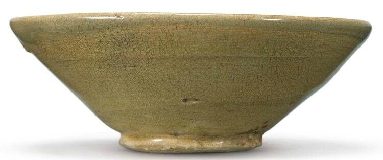A celadon-glazed 'Changsha' bowl, Tang dynasty-Five Dynasties