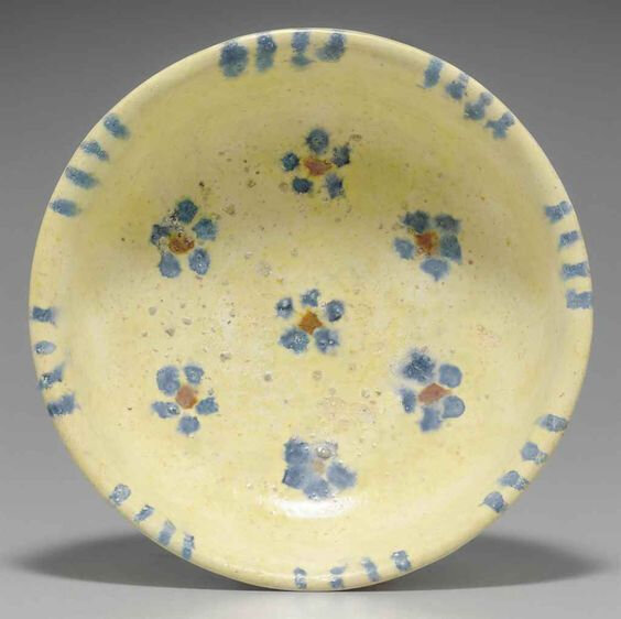 A blue and amber-glazed pottery bowl, Tang dynasty (618-907)