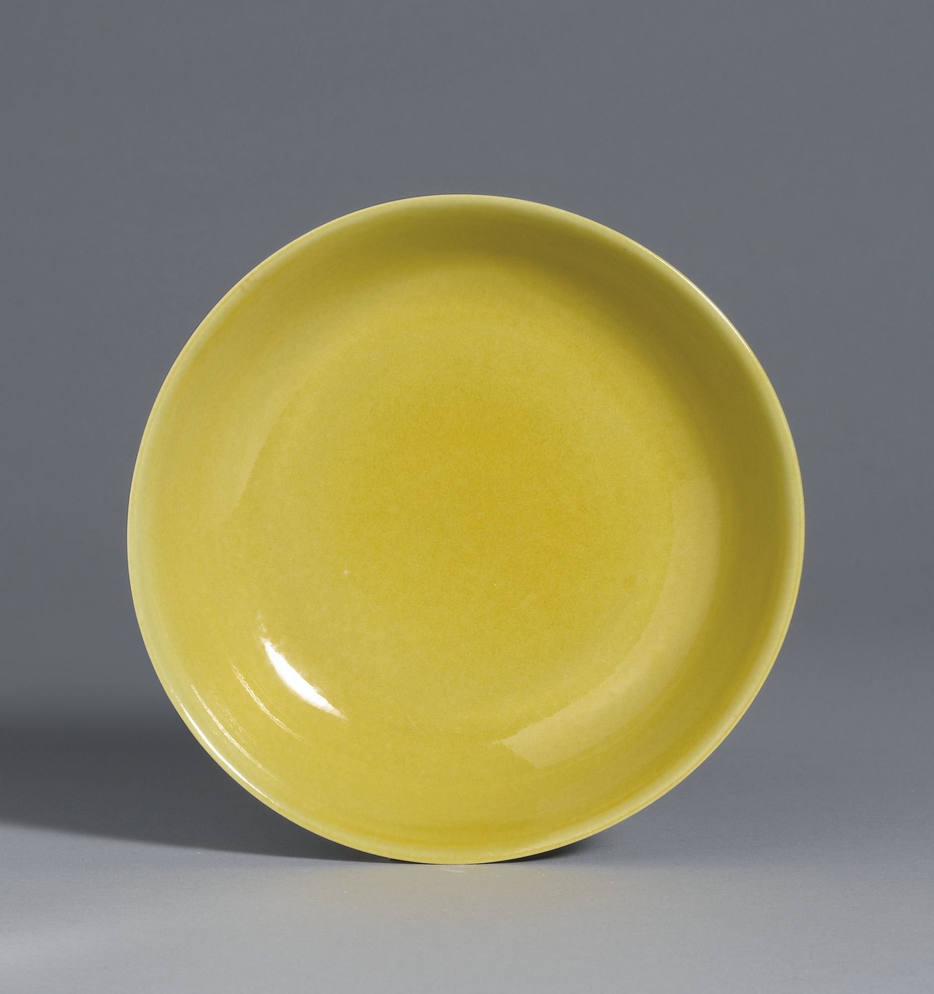 A fine yellow-glazed dish, Mark and period of Zhengde. Photo: Sotheby's.
