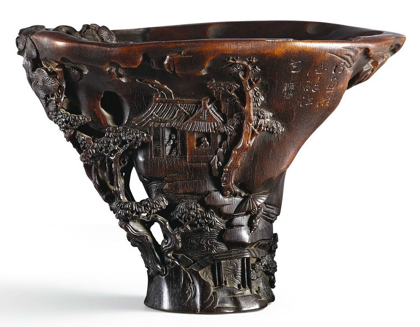 An inscribed rhinoceros horn 'river landscape' libation cup, by Sheng Fugong, 17th century