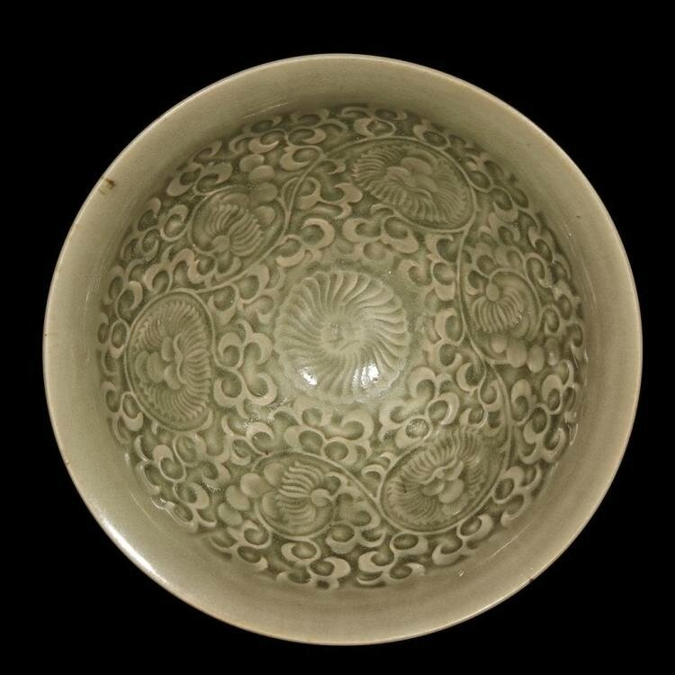 A Chinese Yaozhou celadon-glazed molded conical bowl, Northern Song dynasty (960-1126)