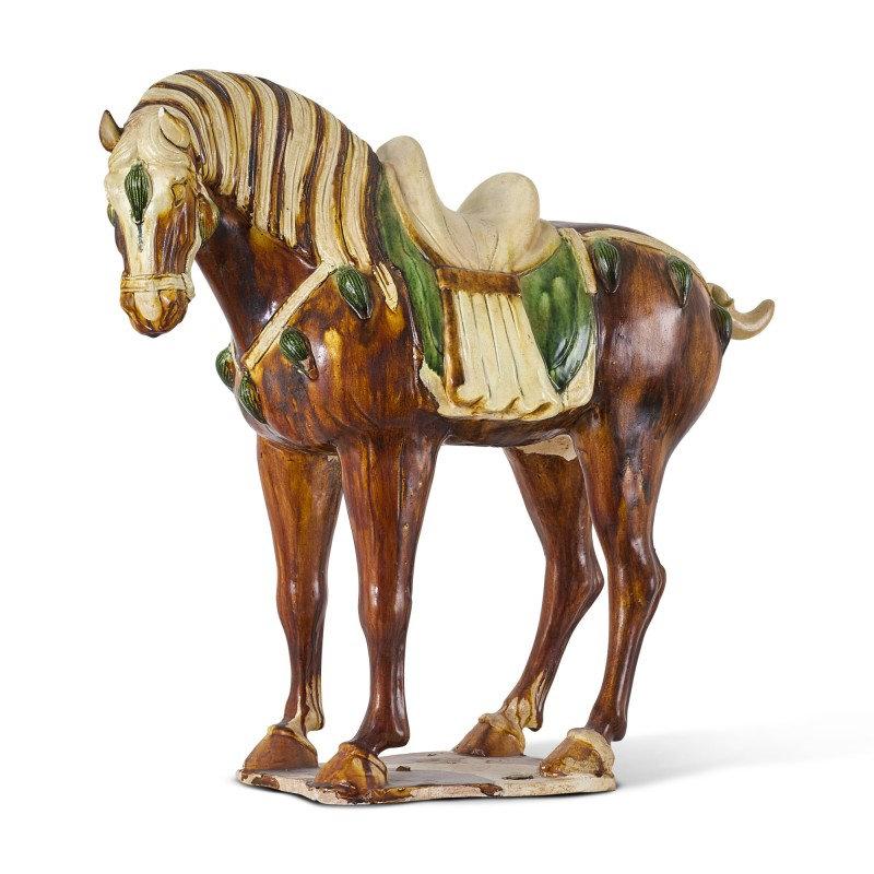 A sancai-glazed pottery figure of a horse, Tang dynasty (618-907)