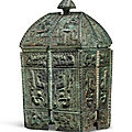 A rare finely cast bronze ritual wine vessel and cover,fangyi, shang dynasty, 13th-11th century bc