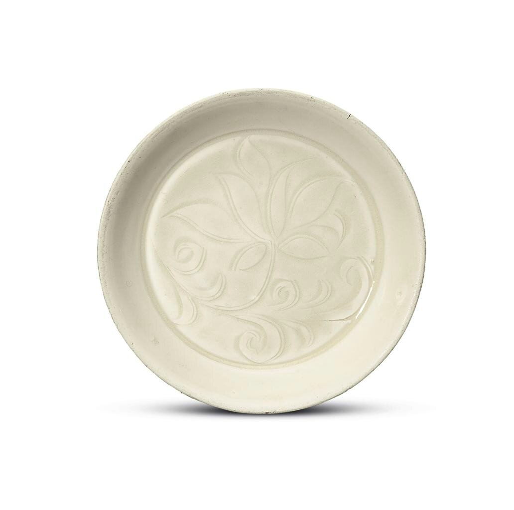 A small carved Ding 'daylily' dish, Northern Song dynasty (960-1127)