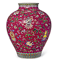 A rare famille-rose ruby-ground jar, qianlong six-character seal mark in iron red and of the period (1736-1795)