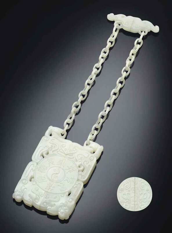 2011_NYR_02427_1533_000(a_rare_white_jade_two-part_archaistic_hanging_tally-form_pendant_18th)