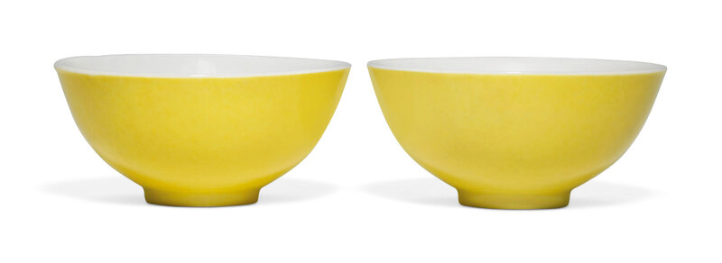 A pair of lemon yellow-enamelled wine cups, Yongzheng six-character marks in underglaze blue within a double circle and of the period (1736-1795)