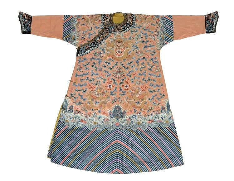 A rare embroidered Imperial apricot ground twelve symbols dragon robe, jifu, 19h century