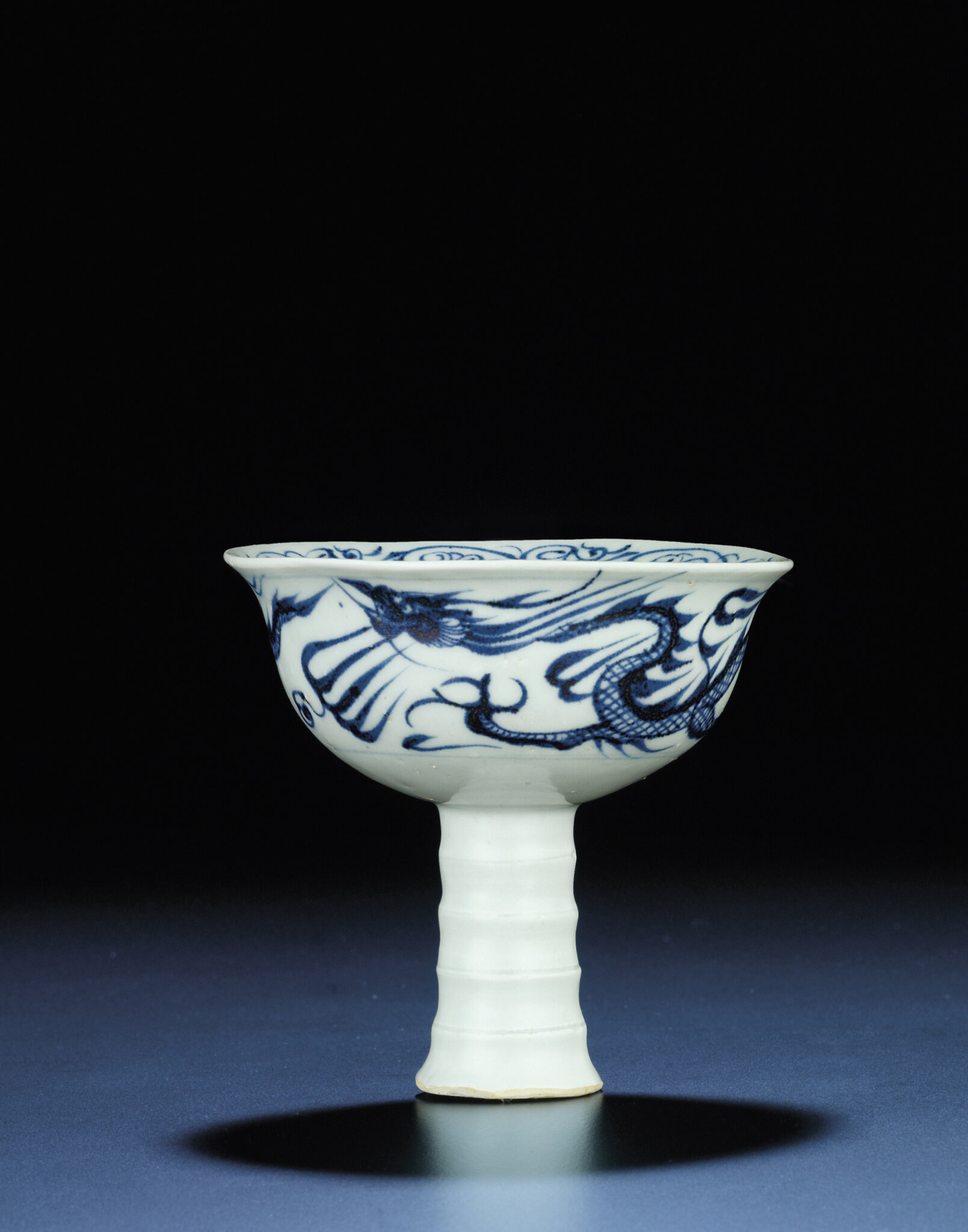 A very rare underglaze-blue moulded 'dragon' stemcup, gaozu wan, Yuan-Early Ming dynasty, late 14th century