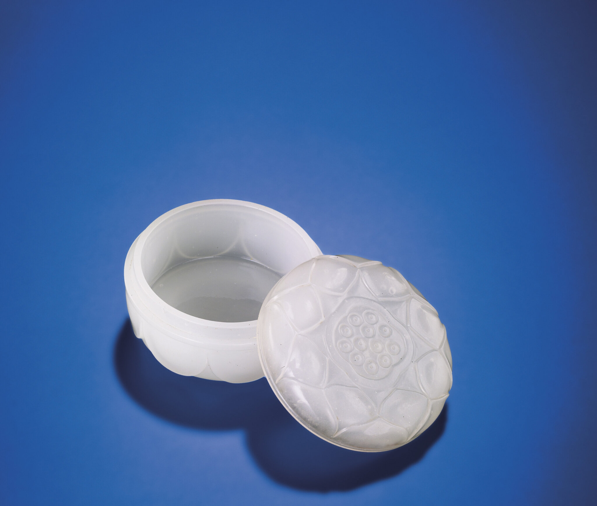 A finely carved white glass 'Lotus' box and cover, Qing dynasty, 18th century