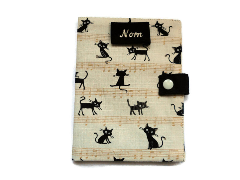 Protge carnet chats noirs partitions cru face
