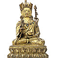 A gilt-copper figure of padmasambhava, tibet, circa 15th century