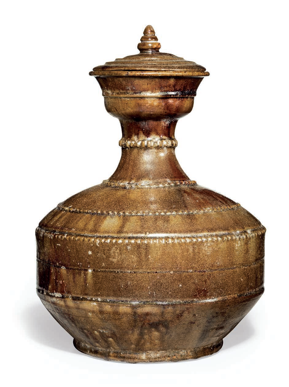 A rare amber-brown-glazed bottle and cover, Tang dynasty (AD 618-907)