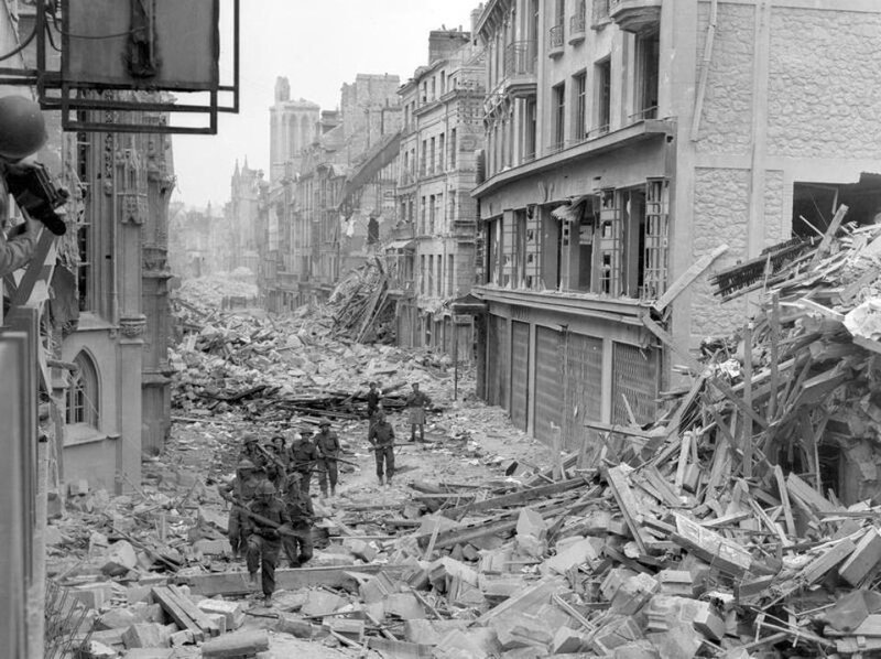 650682-handout-photo-of-canadian-troops-patrolling-along-the-destroyed-rue-saint-pierre-after-german-forces