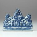 Brush rest moulded in the form of three dragons, China, Ming dynasty (1368 - 1644), Wanli period (1573 - 1619), porcelain with underglaze blue decoration, 13.0 x 17.7 x 4.0 cm. Purchased 1988, 300.1988. Art Gallery of New South Wales, Sydney (C) Art Galler