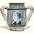 Italian, faenza or perhaps pesaro, circa 1500, double handled albarello with a contour-panel portrait of a lady