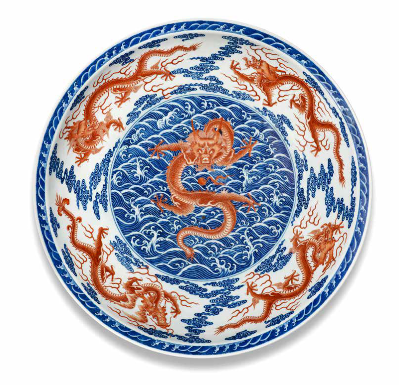 An exceptionally rare and large Imperial underglaze-blue and iron-red enamel 'nine dragon' dish, Qianlong seal mark and of the period (1736-1795)