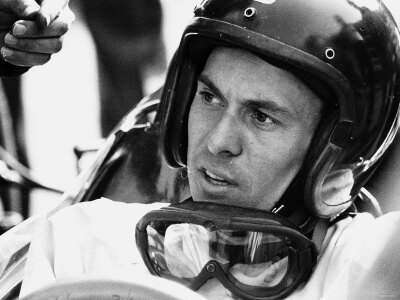 world-champion-racing-driver-jim-clark-wearing-his-helmet-and-goggles-round-his-neck-1964