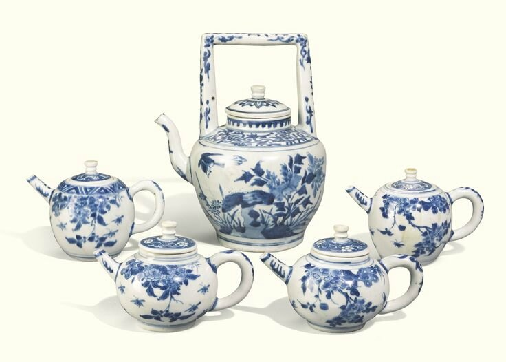 A Chinese large blue and white teapot and cover and four small ovoid teapots and covers, Ming dynasty, circa 1640