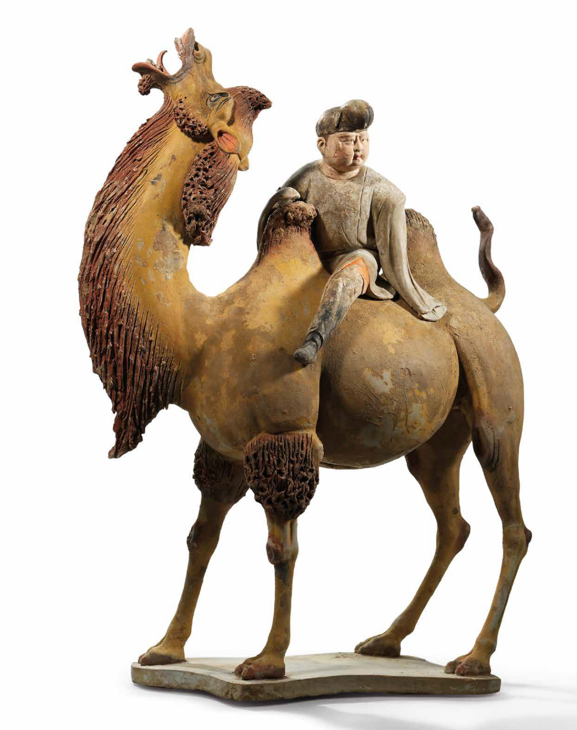 A finely painted pottery figure of a Bactrian camel and rider, Tang dynasty (618-907)