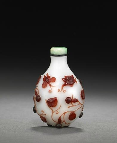 A red overlaid glass snuff bottle decorated with gourds and butterflies. Possibly Imperial, Palace Workshops, Beijing, 1780-1850