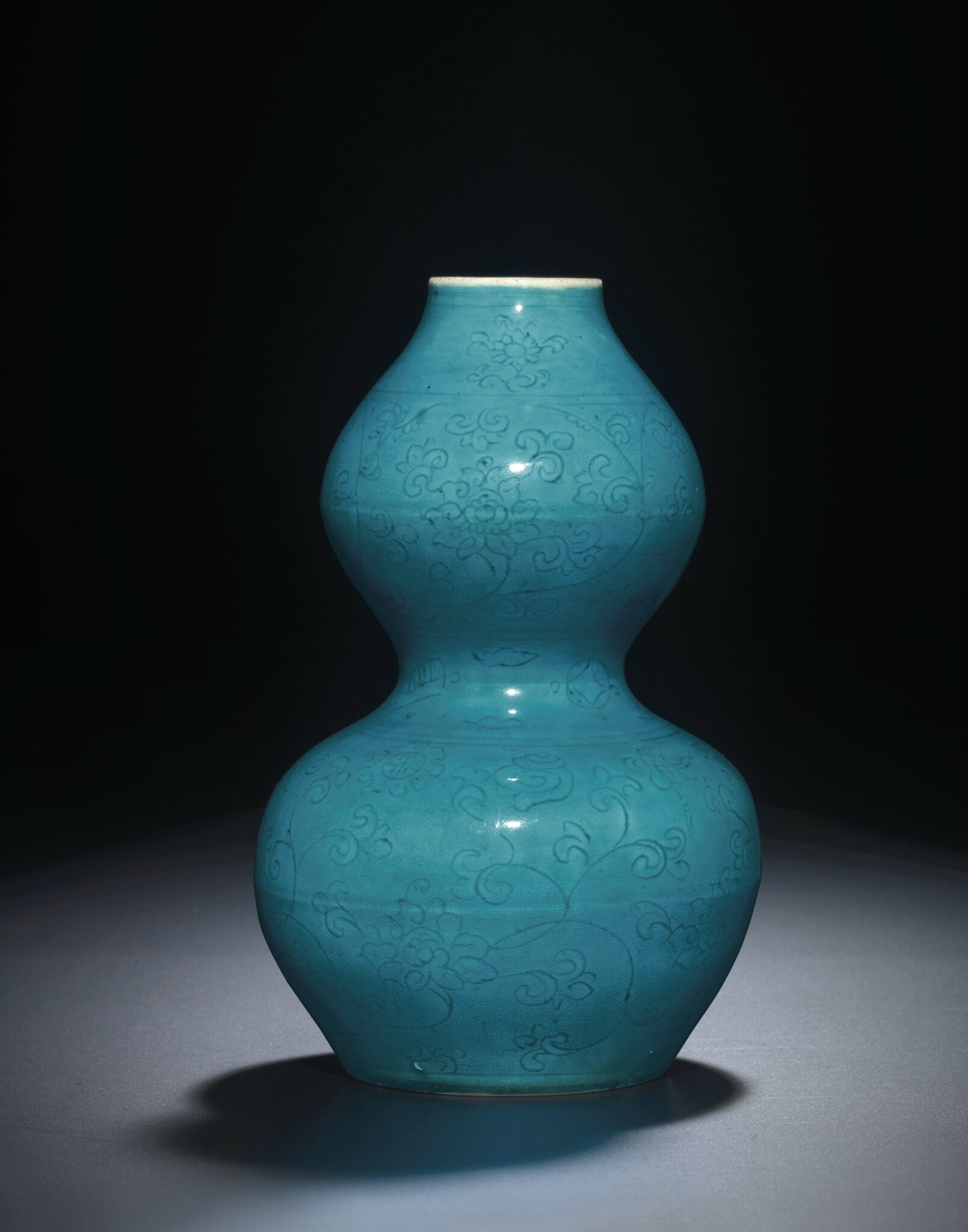 An extremely rare incised turquoise-glazed double-gourd vase, Jiajing six-character mark within double circles and of the period (1522-1566)
