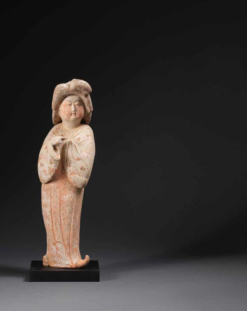 A painted pottery figure of a court lady, Tang Dynasty (618-906)